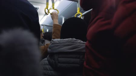 dojíždění : People crowd in subway, rush hour in public transport, risk of pickpocketing