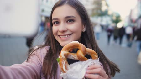 pretzel : Beautiful girl making video about traditional German pretzel, culinary blog Stock Footage