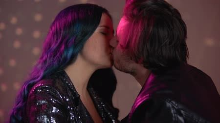 aids : Passionate kiss of young couple at party in club, seduction for one night Stock Footage