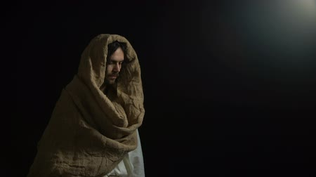 eternal : Biblical prophet in robe looking at light, belief spirituality and religion Stock Footage