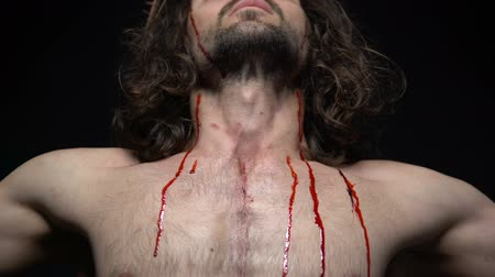 jezus : Gods son crucified on cross suffering agony for sins of mortals, blood dripping