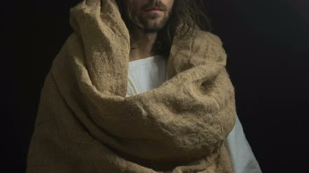 resurrection : Jesus in robe showing bread, helping starving people, God kindness and mercy