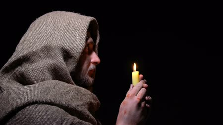 bem aventurança : Sick beggar blowing candle under light from heaven, blessed by God, mercy