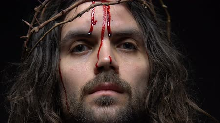 oběť : Bleeding face of Jesus Christ in crown of thorns, suffering from people sins