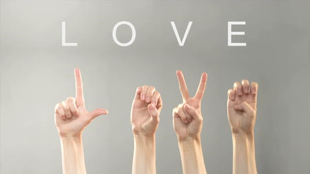 ortografia : Love word written and shown with hands in deaf asl language, expressing feelings