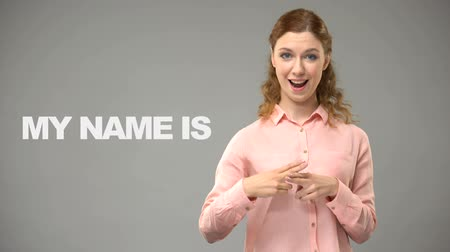 deaf mute : Deaf lady saying nice to meet you in sign language text on background deaf Stock Footage