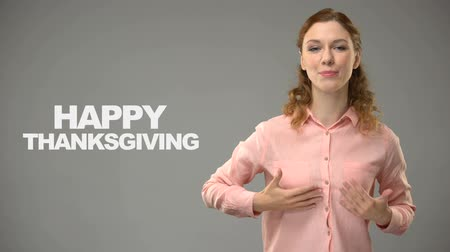 ortografia : Lady saying happy thanksgiving in sign language text on background communication Stock Footage