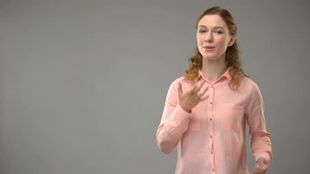 ortografia : Lady saying happy birthday in sign language, teacher showing words in asl lesson