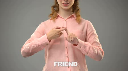 немой : Lady signing friend in asl, text on background, communication for deaf, lesson