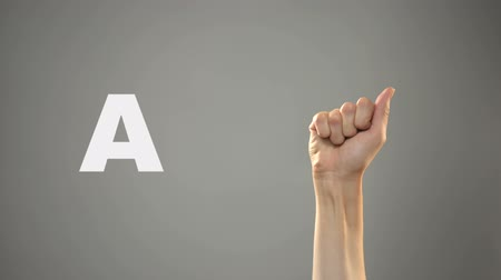 deafness : Letter A in sign language, hand on background, communication for deaf, lesson Stock Footage