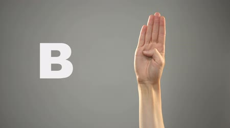 deaf mute : Letter B in sign language, hand on background, communication for deaf, lesson