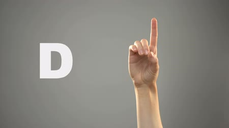 deaf mute : Letter D in sign language, hand on background, communication for deaf, lesson Stock Footage