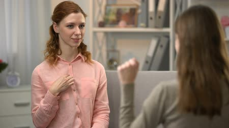 deafness : Deaf woman asking friend if she likes her, conversation in sign language. Stock Footage