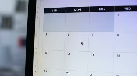 napirend : Date scheduled in online calendar hand pointing at pc screen, important reminder
