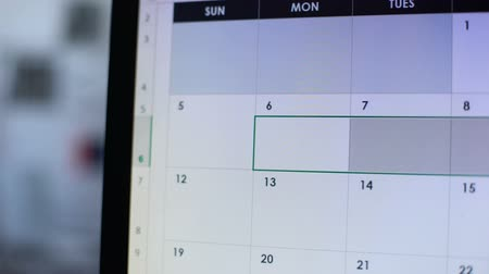 napirend : Person scheduling few days in online diary with red color, holidays, vacation Stock mozgókép