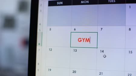 szervez : Gym scheduled in online calendar on computer, active training, healthy lifestyle Stock mozgókép