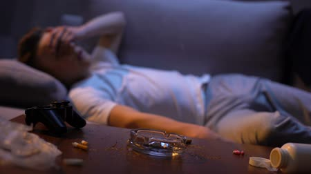 harmful habit : Addicted teenager suffering withdrawal symptoms, young man wasting life, nausea