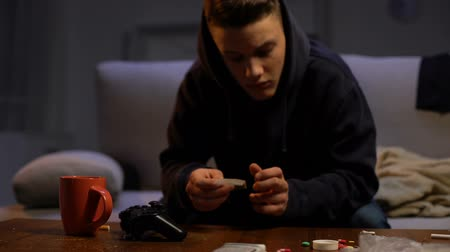 rehabilitasyon : Drug dealer offering addicted teenager weed dose, criminal activity, abuse