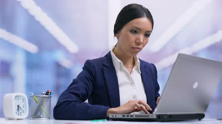 carreira : Satisfied business lady working laptop and relaxing on chair, finished project Stock Footage