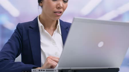 businesslady : Disappointed businesslady feeling unpleasantly surprised closing laptop failure