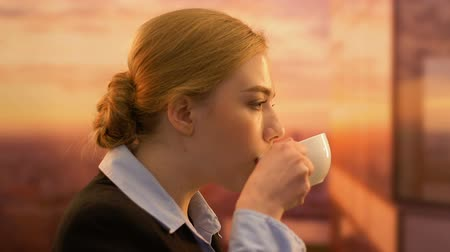 businesslady : Young company partner enjoying morning coffee, successful career, happiness