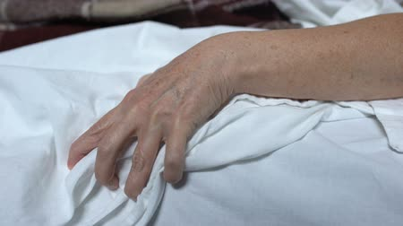 the inflammation : Terminally-ill woman clenching bedsheet feeling terrible pain, death convulsions