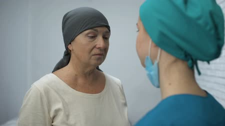 diagnostics : Female patient crying learn about unsuccessful chemotherapy, advanced cancer