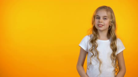 gesticulando : Pretty girl on orange background crossing hands on chest, advertisement template