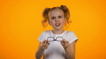 rekomendacja : Little girl irritated with eyeglasses children ophthalmology eyesight correction