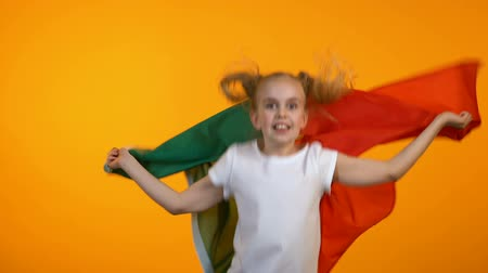 advert : Pretty girl waving with portuguese flag, cheering for favorite football team
