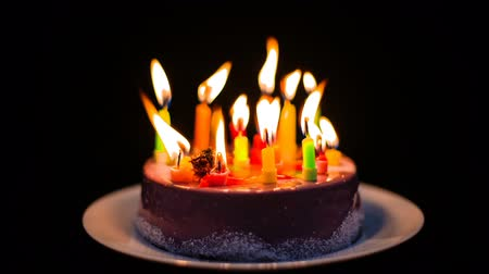 sudden : Candles burning and going out on birthday cake, transience of life.