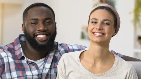 trapo : Smiling mixed-race couple preparing for spring-cleaning, traditions, close-up