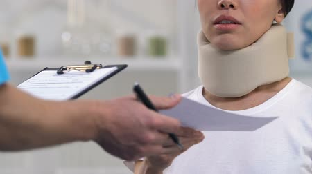 назначение : Doctor giving bill to woman in foam cervical collar, expensive treatment