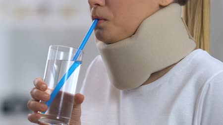 coleira : Girl in foam cervical collar feeling discomfort, orthopedic support, trauma Vídeos