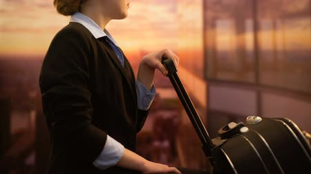 cancelado : Stewardess waiting with luggage in airport, admiring sunrise, business trip Vídeos