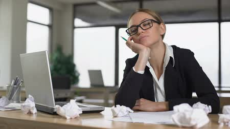 inventor : Bored woman thinking over startup in office, lacking new ideas, unmotivated