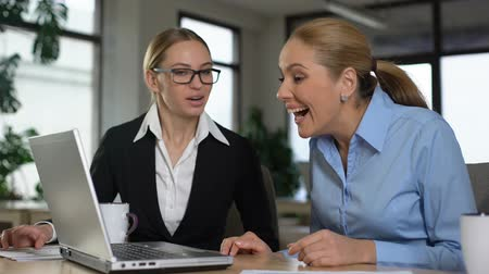 extremely : Female managers reading great news on laptop, rejoicing successful startup Stock Footage