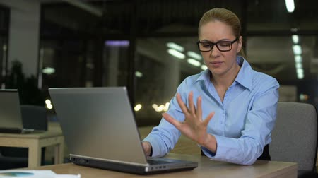osteoarthritis : Woman feels wrist pain caused by excessive use of laptop, carpal tunnel syndrome