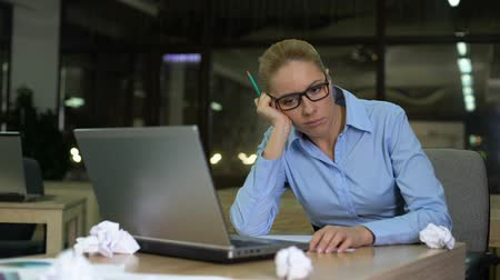 inventor : Exhausted woman lacking business ideas, working extra hours in office, burnout