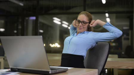 vissza : Productive businesswoman leaning back after finishing office work on laptop