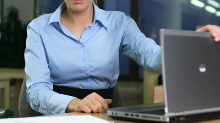 irritação : Disappointed female manager closing laptop in office, work stress, irritation