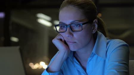 indifference : Exhausted business lady looking at computer screen, lack of energy, overwork
