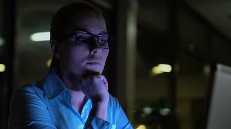 indifference : Night shift employee working in office, feeling bored, support customer service Stock Footage