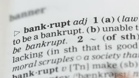 transcription : Bankrupt word in english dictionary pointed with pencil, market failure collapse
