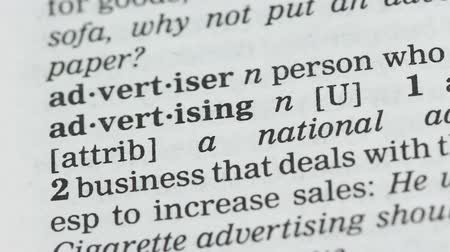 glossary : Advertising, student pointing word in vocabulary, promotion campaign, business Stock Footage