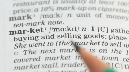 transcription : Market, pencil pointing on definition in english vocabulary, innovative business