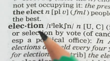 transcription : Election, pencil pointing word on vocabulary in english, free democratic voting Stock Footage