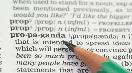 glossary : Propaganda, pencil pointing word on vocabulary in english, population persuasion