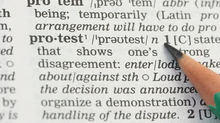 glossary : Protest word meaning in dictionary, state of social disagreement with life event