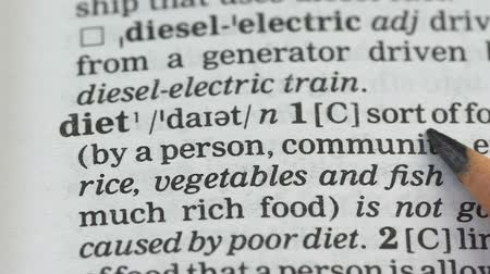 glossary : Diet, pencil pointing word in dictionary, healthy nutrition, diabetes prevention